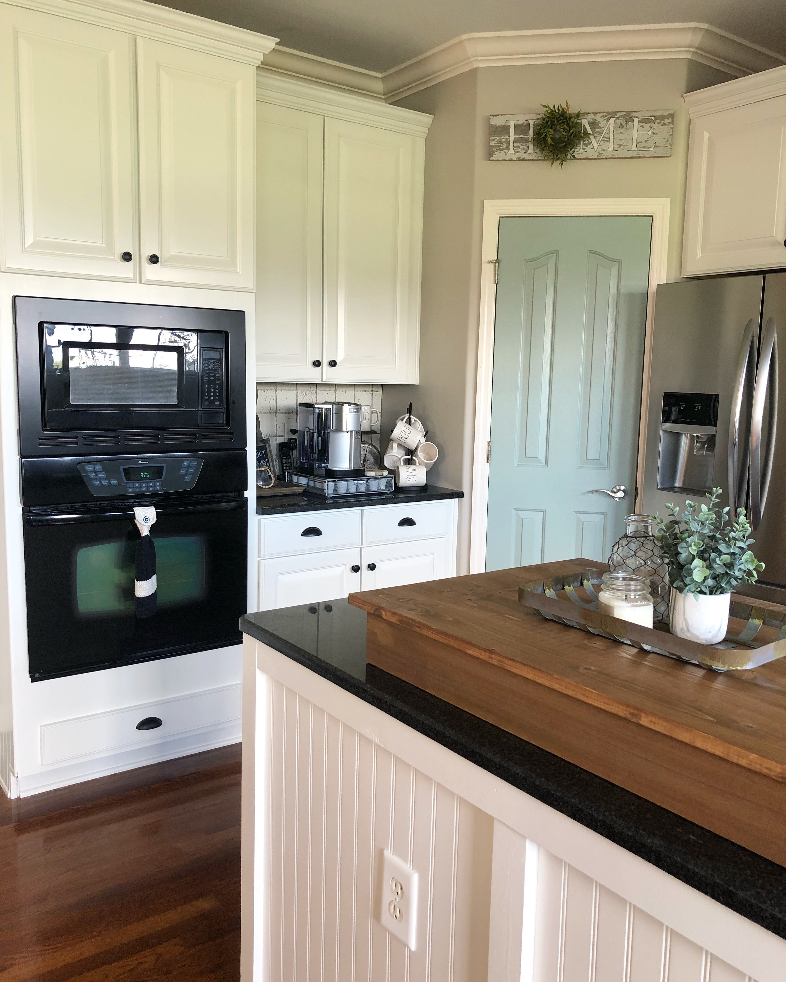 Let Me Know What You Think Of This Painted Kitchen Cabinet Makeover!
