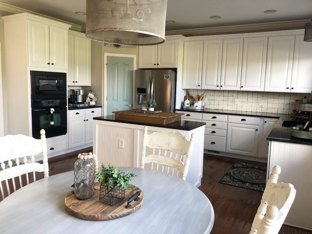 My painted kitchen cabinet makeover, from brown to white ...