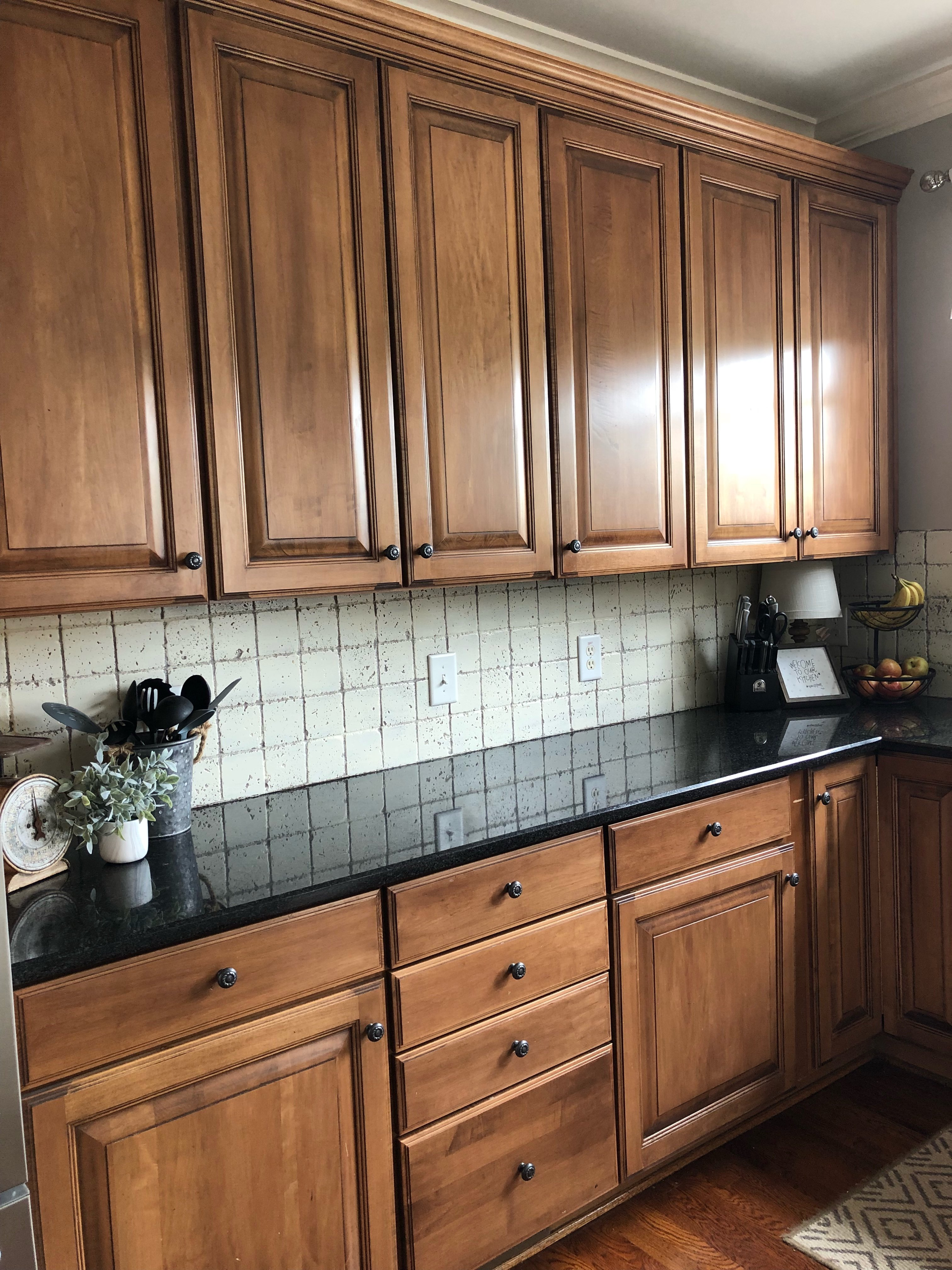 My painted kitchen cabinet makeover, the brown cabinets before they were painted white