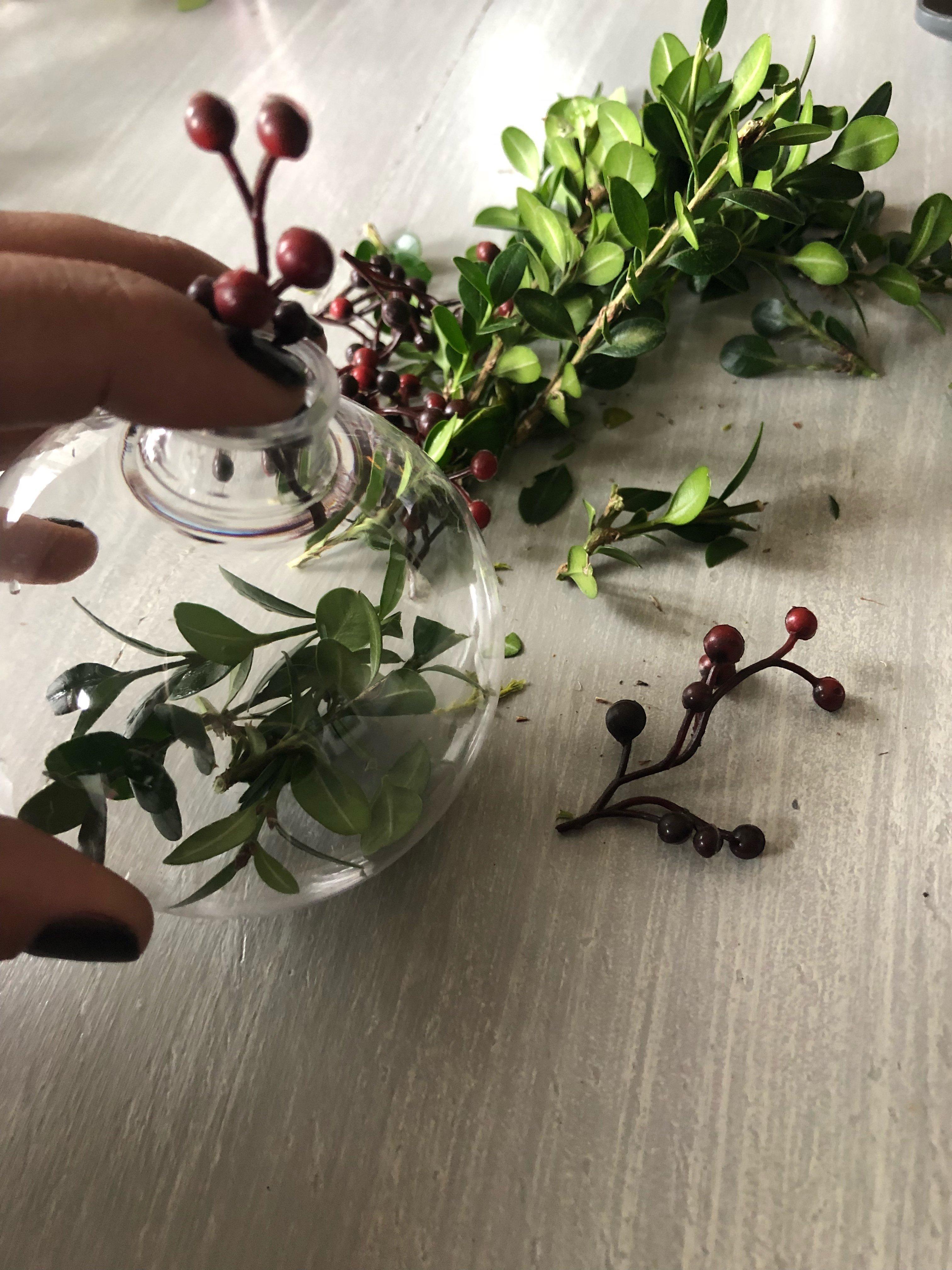 DIY Christmas ornaments using real greenery inside plastic ornaments