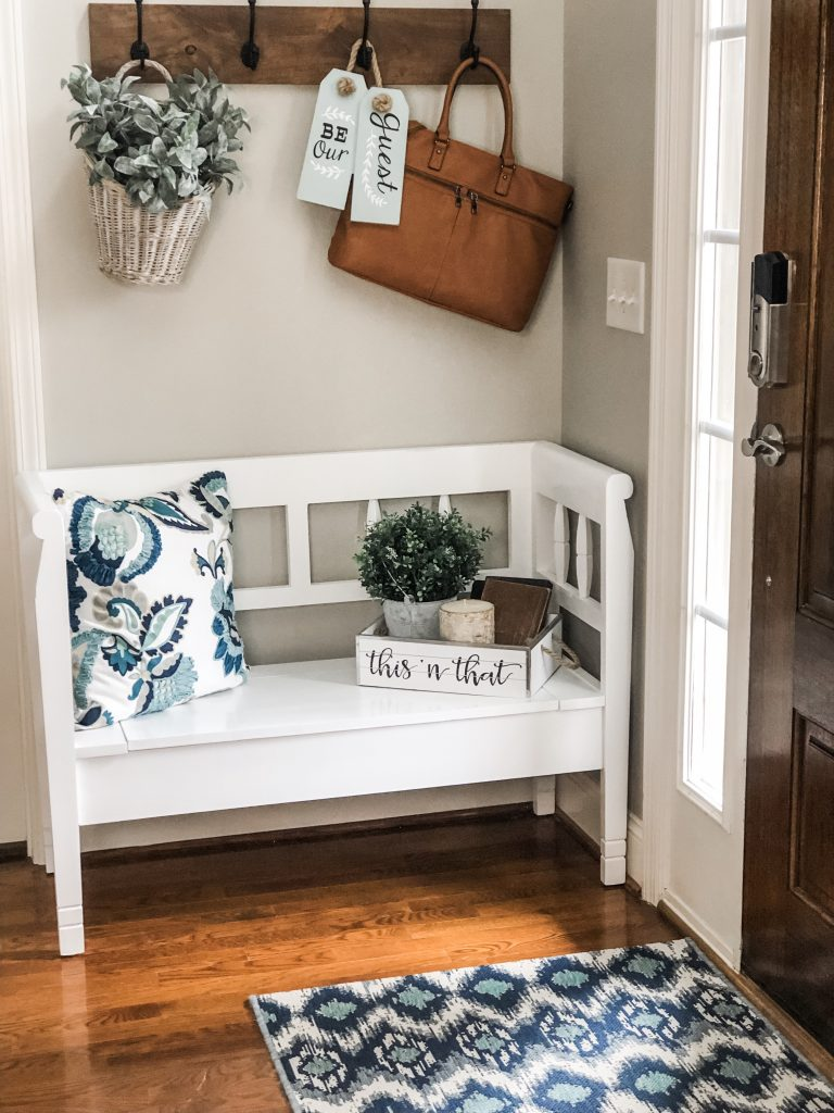 Entry way decorating ideas with a storage bench, decor and hooks