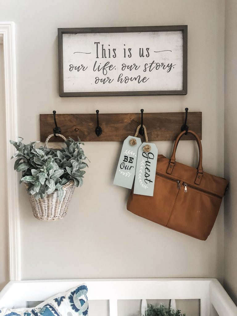 Entry way decorating ideas with a storage bench, hooks and decor