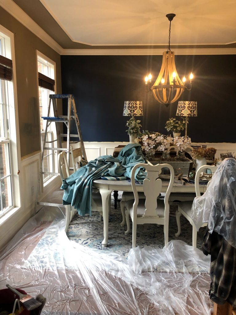 Navy paint on an accent wall in my dining room, one coat of navy