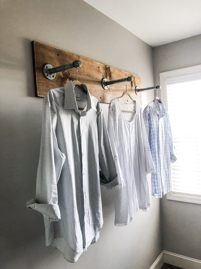 DIY clothing rack for your laundry room with industrial pipes and wood