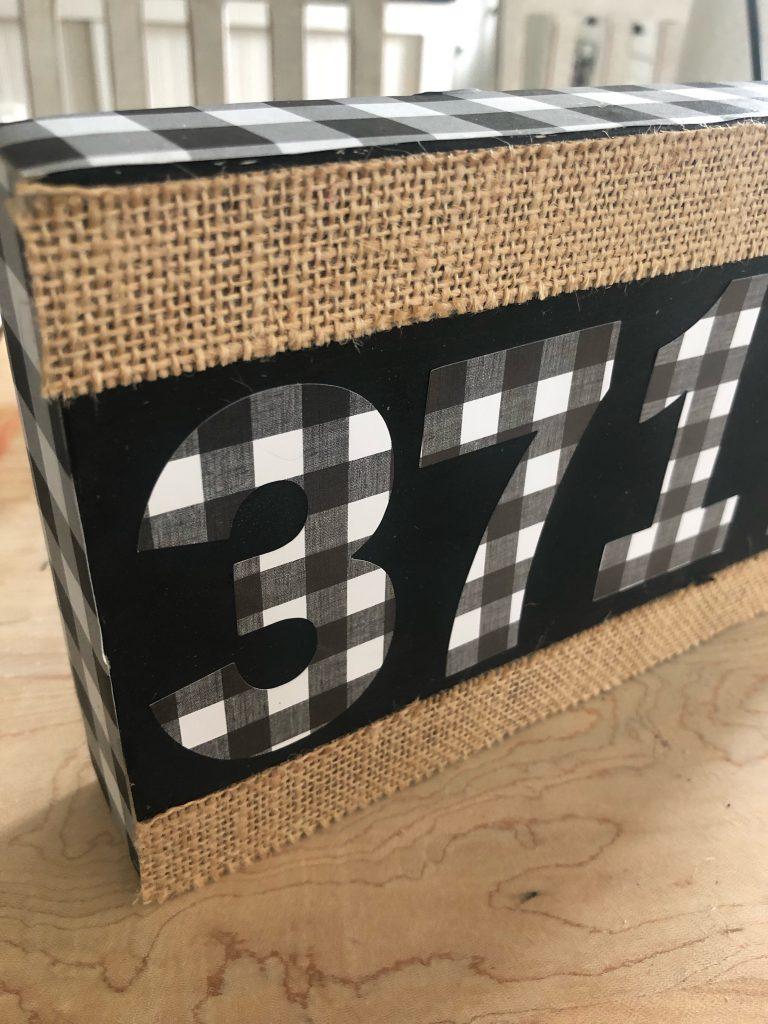 DIY zip code sign using scrap wood and stickers
