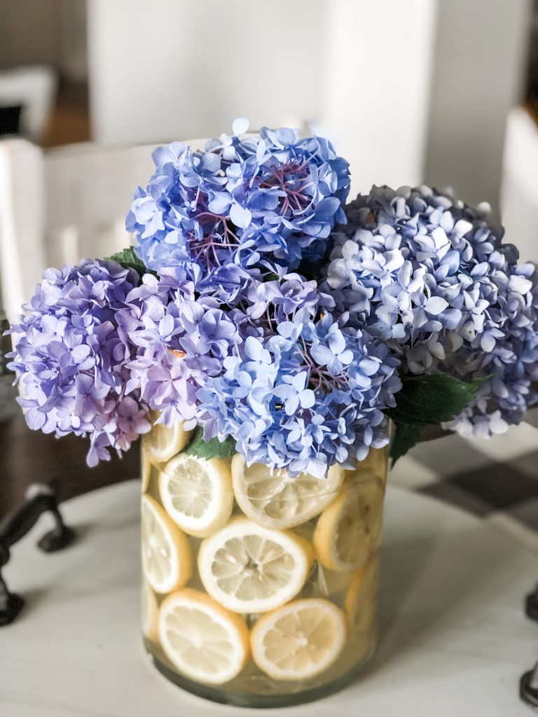 Lemon vase floral centerpiece hack with hydrangeas and lemons!